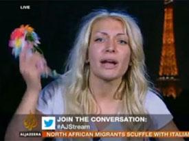 Rusia Una activista de FEMEN se desnuda en directo en Al-Jazeera, octubre 2012